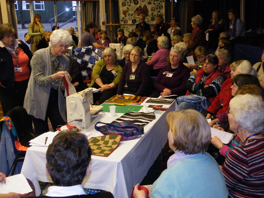 Sue Maudling shows a section of curved piecing